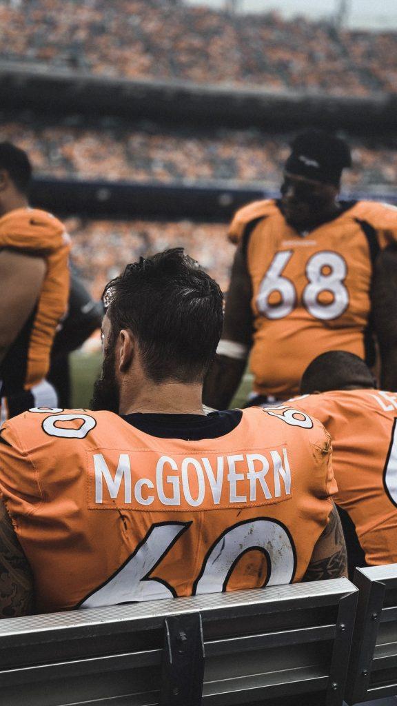 man in orange jersey shirt