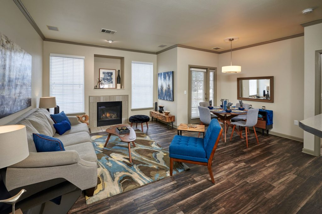 A living room with hardwood-style floors at Gateway Park Apartments in Denver, Colorado