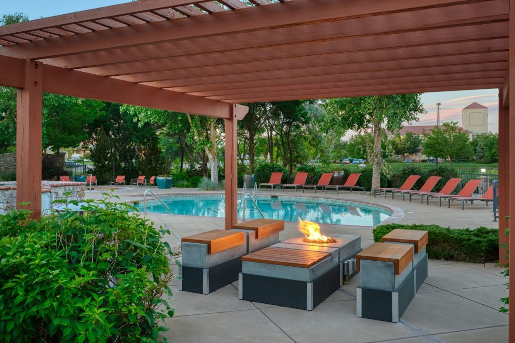 Poolside lounge area with a fire pit at Gateway Park Apartments in Denver, Colorado